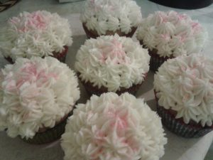 White frosting with pink sprinkles