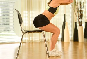 If you have never done squats before, then start by using a chair.  Come down on the chair and next time come down so you are barely touching the chair.  Work your way to not using a chair at all.  Be sure to keep good form!