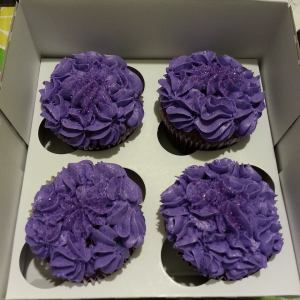 Purple and grape flavoured frosting, purple sprinkles, purple cupcake, purple wrapper for the purple loving person!